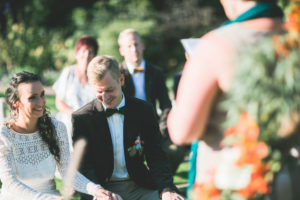Alternate bridal couple at wedding ceremony outdoors,