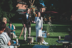 Alternate bridal couple at spiritual wedding ceremony outdoors