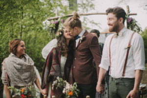 Alternate bridal couple at wedding ceremony outdoors
