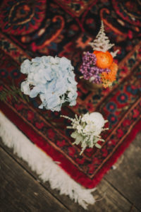 Floral decoration on carpet at alternative wedding celebration, close up