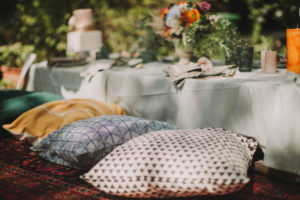 Festive laid table at alternative wedding celebration outside, detail