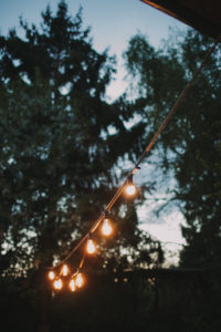 Alternative wedding, garden, decoration, string of lights, evening