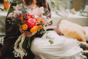 Alternative wedding, bride with bouquet, close up