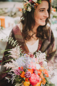 Alternative wedding, bride with bouquet, happy, laugh, portrait