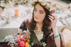 Alternative wedding, bride with flower rim and bouquet, eyes closed, portrait