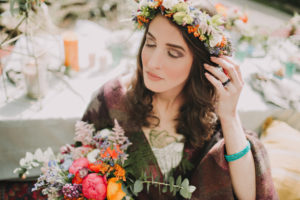 Alternative wedding, bride with flower rim and bouquet, eyes closed, portrait