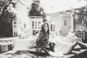 Alternative wedding, bride on hassock in the garden, happy, smile, b/w