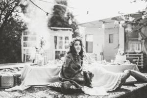 Alternative wedding, bride on hassock in the garden, happy, smile, b/w
