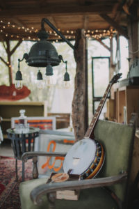 garden shed, inside, furnishing, armchair, banjo, string of lights
