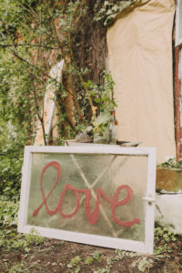 Garden, tree, sign / old window with the inscription 'Love'