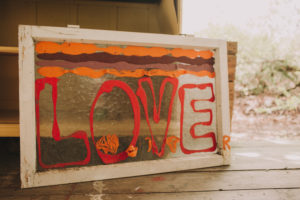 garden shed, sign / old window with the inscription 'Love'