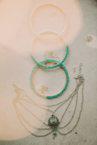 Jewellery at alternative wedding celebration, bangles and necklace,