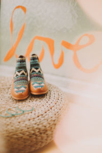 Women's shoes with Ethno pattern, bangles, Love, still life