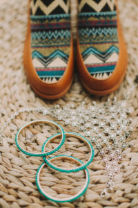 Women's shoes with Ethno pattern and bangles, still life