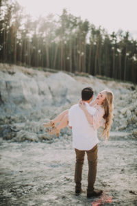 Couple in love, gorge, happy, man carries wife