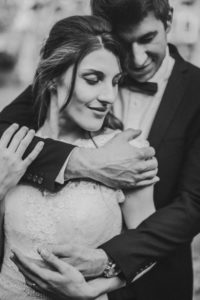 Bridal couple in love, standing, hug, smiling, detail,