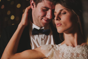 Bridal couple in love, standing, hug, portrait, detail,
