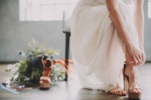 Bride puts on her shoes, detail,
