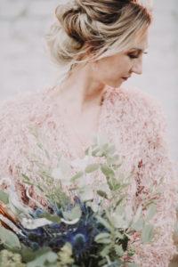 Bride with bouquet, serious, side view, portrait,