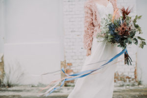Bride with bouquet, standing, outside, detail,