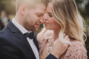 Bridal couple outside, touching, in love, portrait, detail, blur,