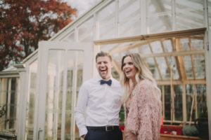 Happy bridal couple, laughing outside, half portrait,