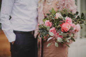 Bridal couple with flower bouquet, detail,