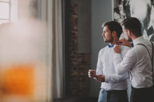 Wedding, groom and best man, help with bow tie,