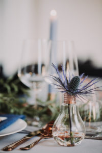 laid wedding table, detail, lightbulb, thistle, blur,