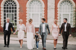 Wedding photo, newlyweds, bridal parents, groomsmen, son, walk, hand in hand,