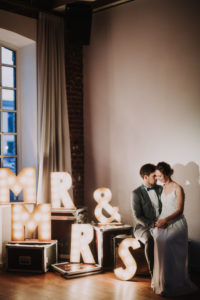 Happy bridal couple, sitting, decoration, illuminated letters