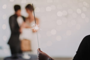 Bridal couple, blur, detail, woman holding sparkler,