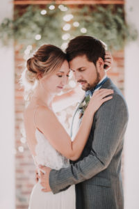 Happy bridal couple, hug, closed eyes, half portrait, side view,