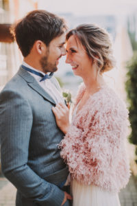 Bridal couple in love, smiling, half portrait,