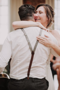 Happy bride hugs a man, congratulations,
