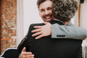 Wedding, groom and senior, hug, smile,