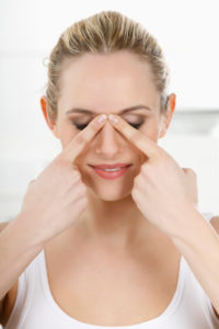 Woman is doing a facial massage