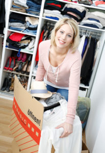 Woman is standing in front of her closet