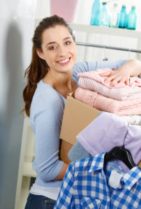 Woman holds a box of clothes