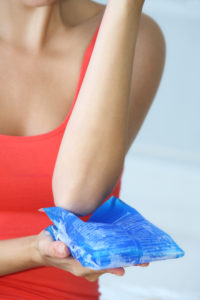 Woman with a cooling pad