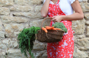 Woman with a basket of vegetables