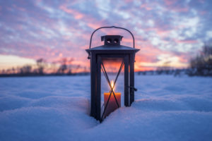 Germany, Lower Saxony, Brunswick, Riddagshausen, lantern in the snow in the evening