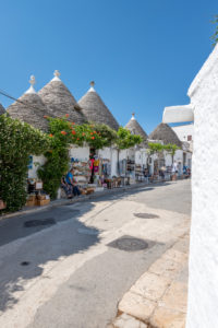 Alberobello, Bari province, Salento, Puglia, Italy, Europe. The typical trulli houses with their cone-shaped roof in the drywall style