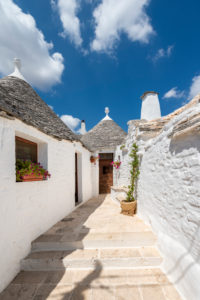 Alberobello, Bari province, Salento, Puglia, Italy, Europe. Entrance to a typical trullo with its conical roof