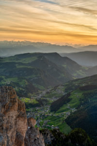 Gardena Pass, Bolzano Province, South Tyrol, Italy. View at sunset from the summit of the Großer Cirspitze down into the Val Gardena valley