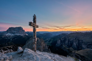Gardena Pass, Bolzano Province, South Tyrol, Italy. View at sunset from the summit of the Großer Cirspitze down into the Val Gardena valley and to the Sassolungo