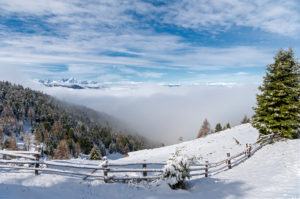 Percha, Bolzano province, South Tyrol, Italy. Snow in spring above the Gönner Alm. In the background the Dolomites