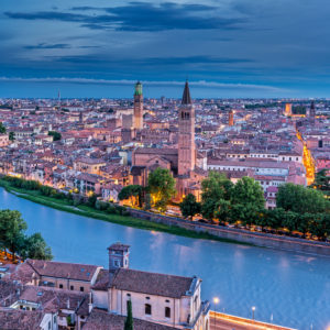 Verona, Province of Verona, Veneto, Italy. Evening view from Castel San Pietro down to the Adige river and the city of Verona
