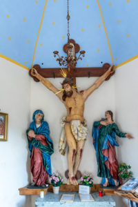 Villanders, Bolzano Province, South Tyrol, Italy. The crucifixion group in the Totenkirchl on the Villanderer Alm