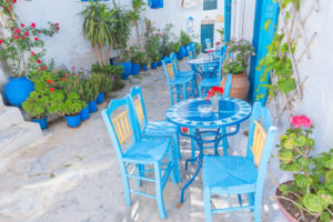 Streetside cafe tables and chairs, Amorgos, Cyclades Islands, Greece, Europe